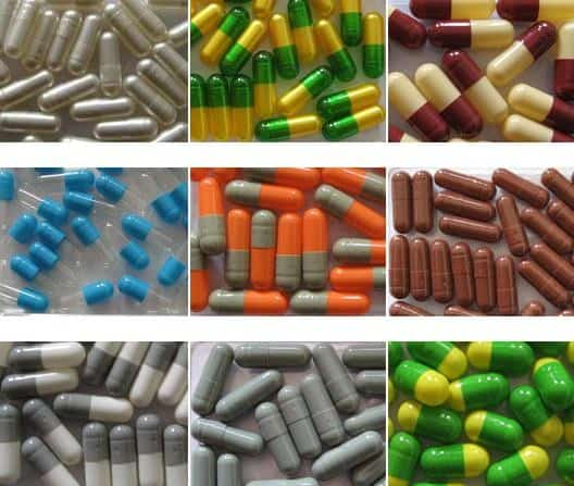 different sizes and colors of capsules